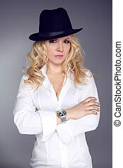 Woman wearing in white shirt and black hat isolated on grey background