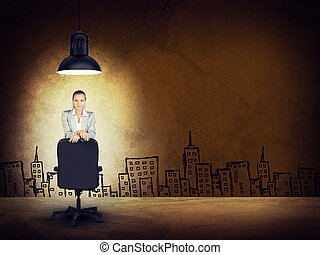 Woman wearing jacket, blouse leaning on chair. Background sketch of buildings