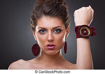 woman wearing leather jewlery