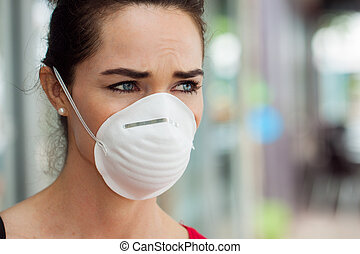 Woman wearing mask in city.