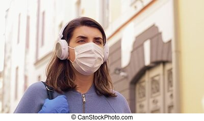woman wearing medical mask and gloves in city - health, ...