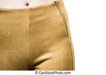 Woman wearing mustard tight pants