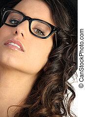 Woman wearing pair of glasses