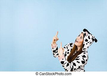 Woman wearing pajamas cartoon pointing up