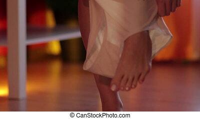 Woman wearing panties in room - Slow motion of crop legs of...