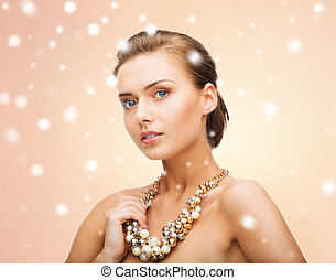 woman wearing pearl statement necklace - beauty and jewelery...