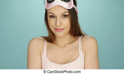 Woman Wearing Pink Sleep Mask