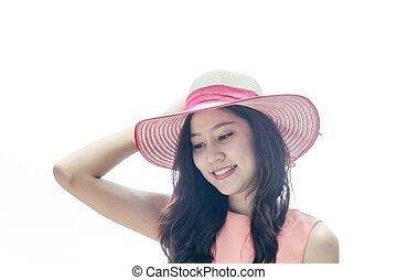 woman wearing pink straw hat with expression of happy -...