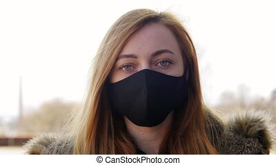 woman wearing protective reusable barrier mask - health, ...