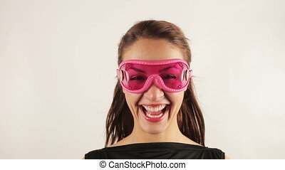 woman wearing retro goggles making faces