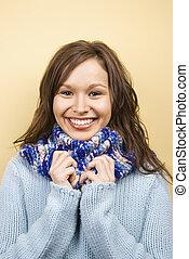 Woman wearing scarf.