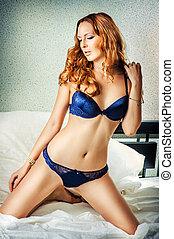woman wearing sexy dark blue lingerie - young beautiful...