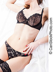Woman wearing sexy underwear in a bed