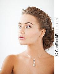 woman wearing shiny diamond necklace - close up of beautiful...