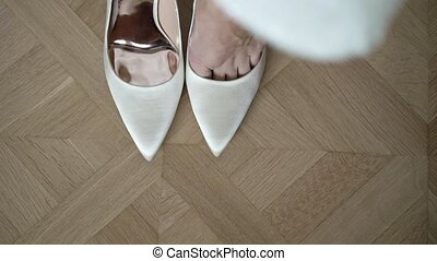 Woman wearing shoes on heels