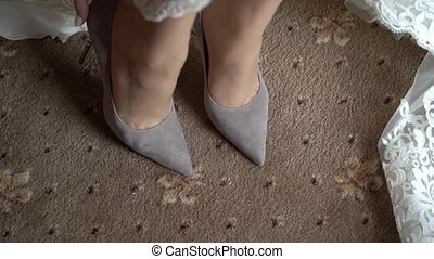 Woman wearing shoes - Woman wearing gray shoes indoors