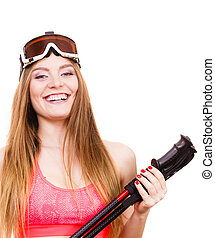 Woman wearing ski suit holding poles