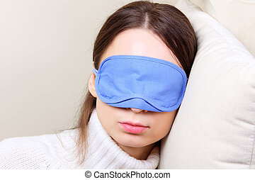 Woman wearing sleep mask - Young woman in a sleeping eye ...