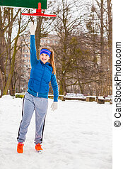 Woman wearing sportswear urban exercising outside during winter