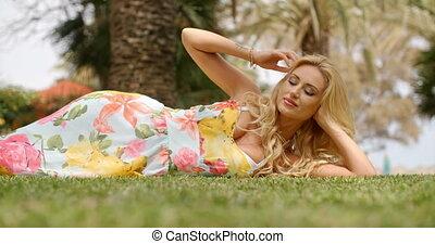 Woman Wearing Sun Dress Lying on Side on Grass - Blond Woman...