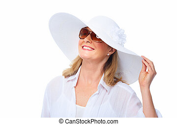 Woman wearing sunglasses and a hat.