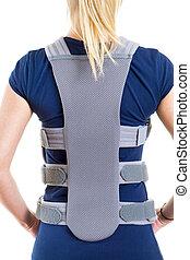 Woman Wearing Supportive Back Brace in Studio