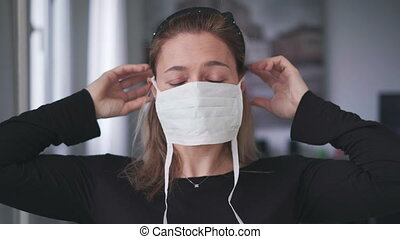 woman wearing surgical mask for corona virus isolation .