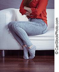 Woman wearing tight skinny blue jeans