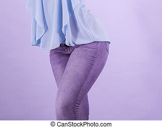 Woman wearing tight slim jeans