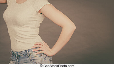 Woman wearing tight slim jeans and white tshirt