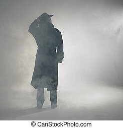 Woman wearing trench coat and standing in fog - woman with...