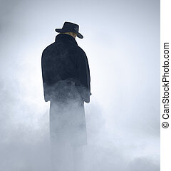 woman with dark coat standing in the fog