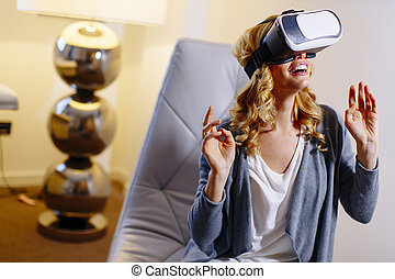 Woman wearing virtual reality goggles in the room