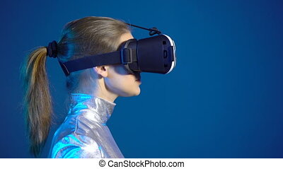 Woman wearing virtual reality googles looking at blank copy space