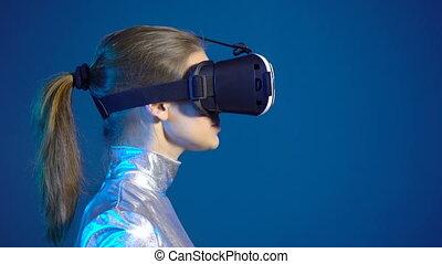 Woman wearing virtual reality googles looking at blank copy space