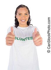 Woman wearing volunteer tshirt and giving thumb up
