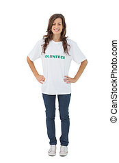 Woman wearing volunteer tshirt putting her hands on hips on ...