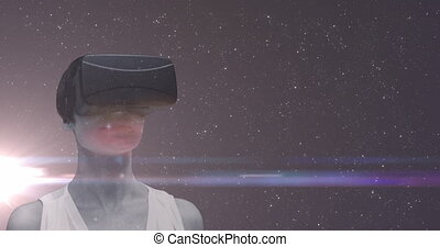 Woman wearing VR headset over universe with multiple stars and glowing spot of light in the backgrou