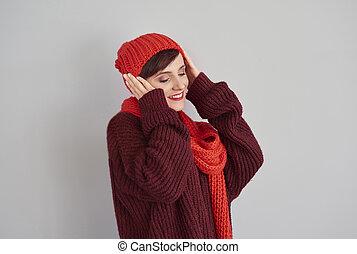 Woman wearing warm cap on her head