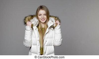 Woman wearing warm winter coat - Blond woman wearing warm...
