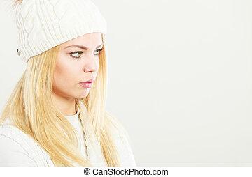 Woman wearing warm winter woolen cap