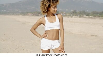 Woman Wearing White Top And Hot Pants - Woman standing on...