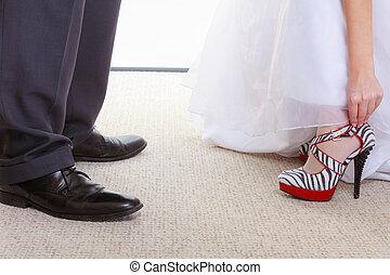 Woman wearing zebra pattern shoes and wedding dress