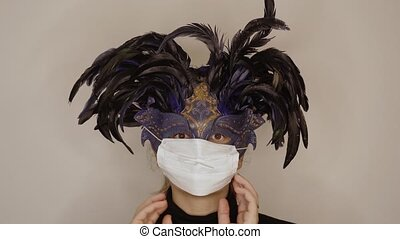 Woman with carnival mask wears white surgical mask