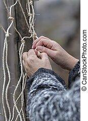 woman weaving networks