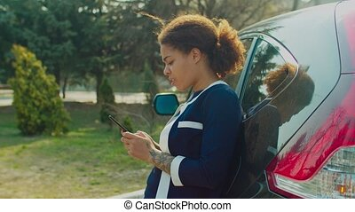 Woman web surfing on phone for roadside assistance - Unhappy...