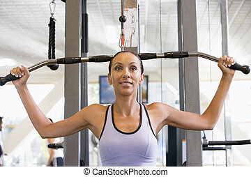 Woman Weight Training At Gym