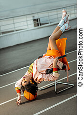 African American retro styled girl lying upside down