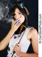 Woman Welding Smoking Cigarette