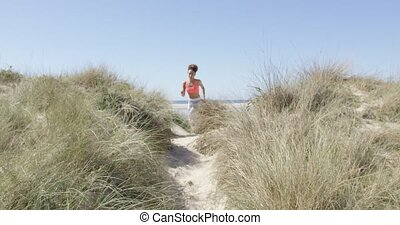 Woman while doing cardio - Horizontal outdoors shot of young...